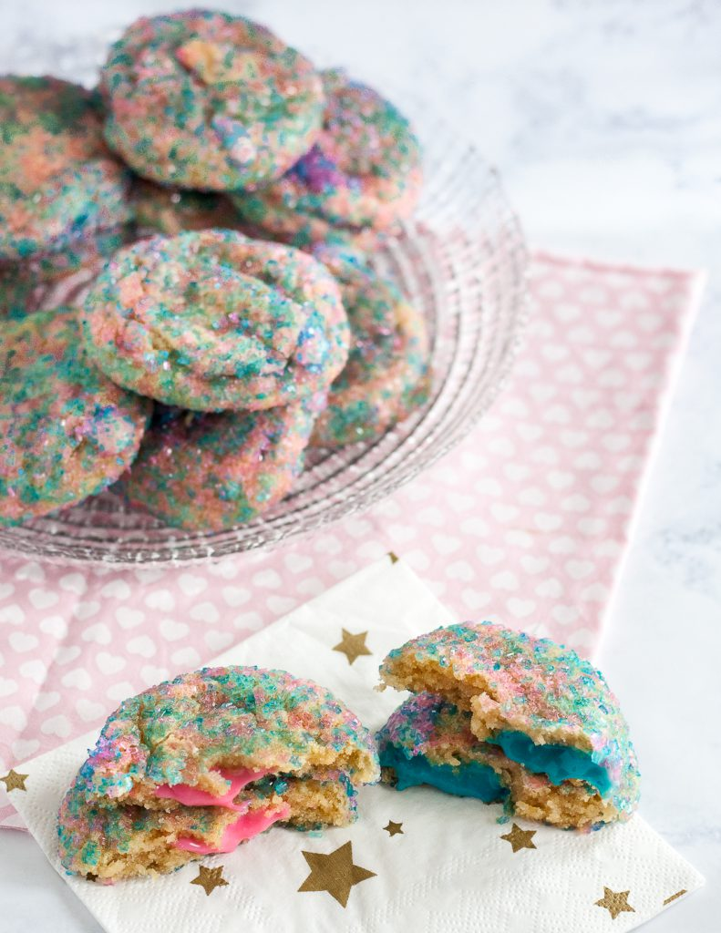 Go beyond cake with your gender reveal ideas! Gender reveal cookies are a unique way to share your baby's gender with a group, or with family and friends far away - they ship! * Recipe and Video Tutorial on GoodieGodmother.com
