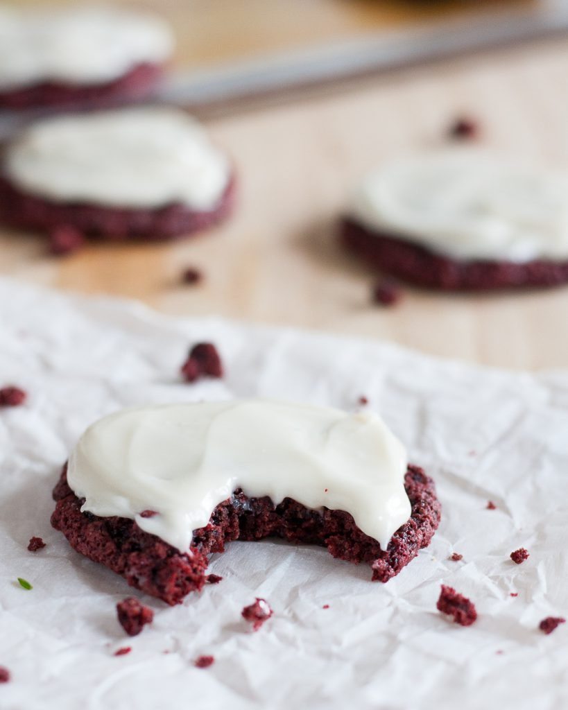 Perfect for Christmas, Valentine's Day, or really any time you need a treat, these soft frosted vegan red velvet cookies are delightful! * Recipe on GoodieGodmother.com