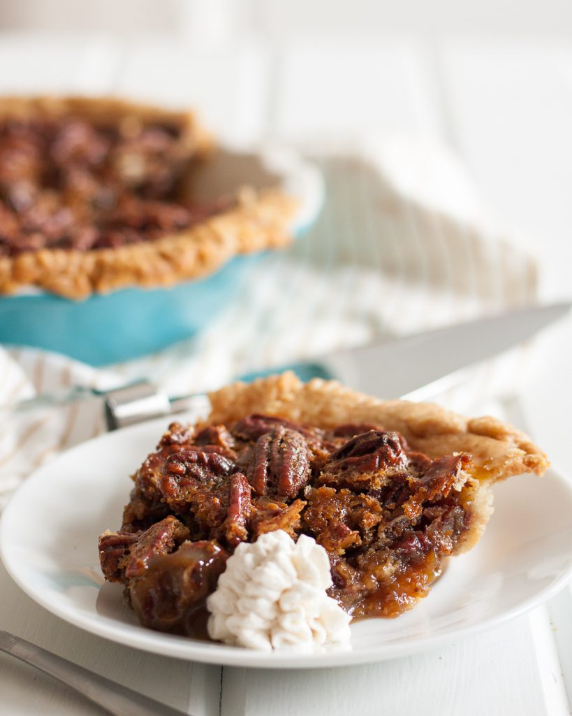 White Russian Pecan Pie - inspired a little by happy hour, a lot by a road trip, this unique pecan pie recipe is amazing! It's a must for our Thanksgiving table. * Recipe on GoodieGodmother.com