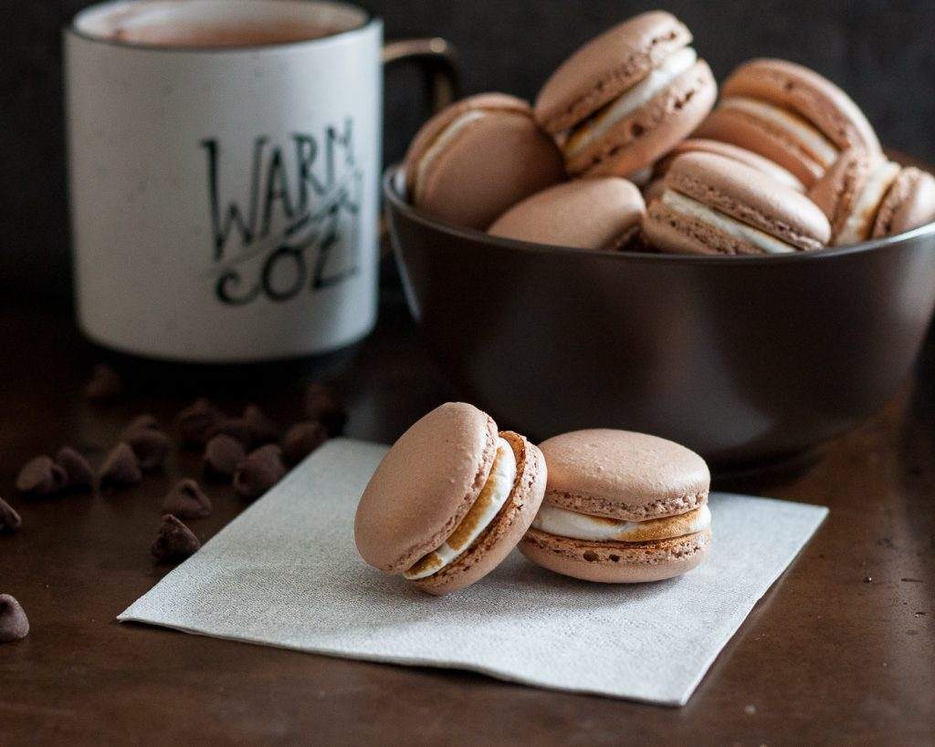 The weather outside is frightful, but hot chocolate macarons are sure to warm your heart - delightful fireplace burning or not.  * Recipe on GoodieGodmother.com