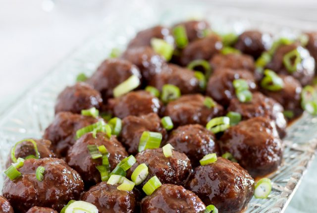 Slow cooker guava glazed meatballs is a great dish to serve at parties! This recipe is a unique spin on traditional slow cooker meatball recipes. * Recipe on GoodieGodmother.com