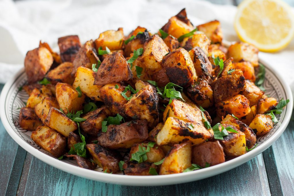 This recipe has a hint of lemon, the right amount of paprika, and an incredible crispy texture. These crispy oven roasted Spanish potatoes are delicious! * Recipe on GoodieGodmother.com