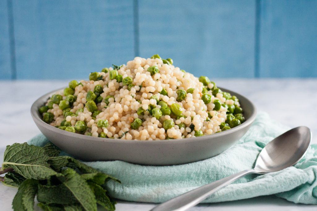 Use fresh or frozen peas to make this mint pea couscous. The recipe is perfect for spring! * GoodieGodmother.com