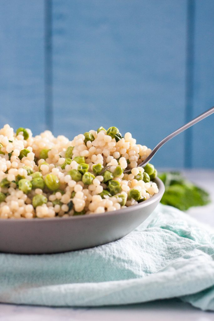 Mint Pea Couscous salad is a great light side dish for roasts like lamb or ham. * Recipe on GoodieGodmother.com