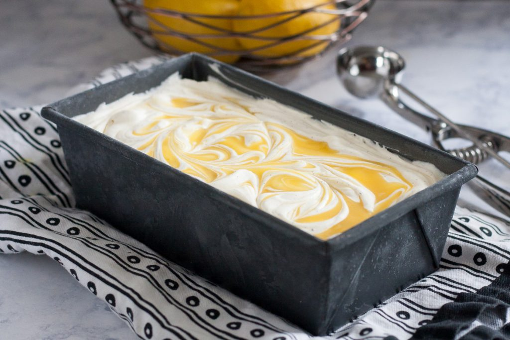No churn vanilla bean lemon curd ice cream is a refreshing treat! It's creamy no churn vanilla bean ice cream with a tart sweet swirl of lemon curd. * Recipe on GoodieGodmother.com