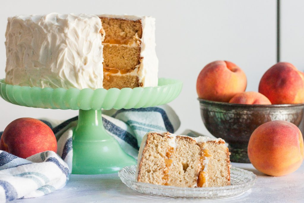 Fresh peaches, and a little peach wine, make this peach wine cake from scratch a delicious cake fit for a Southern belle! * GoodieGodmother.com