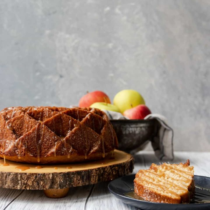Imagine fall in a bite. This caramel apple cider bundt cake is like the cake version of apple cider doughnuts, with loads more apple flavor, and caramel. *Apple Cider Doughnut Cake Recipe on GoodieGodmother.com