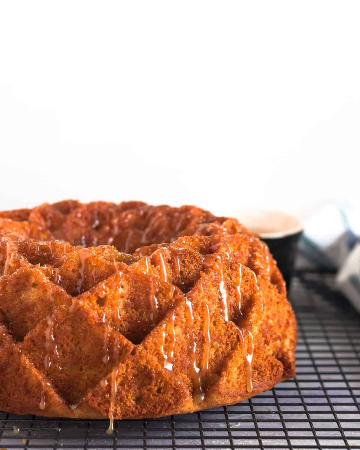 Imagine fall in a bite. This caramel apple cider bundt cake is like the cake version of apple cider doughnuts, with loads more apple flavor, and caramel. * GoodieGodmother.com