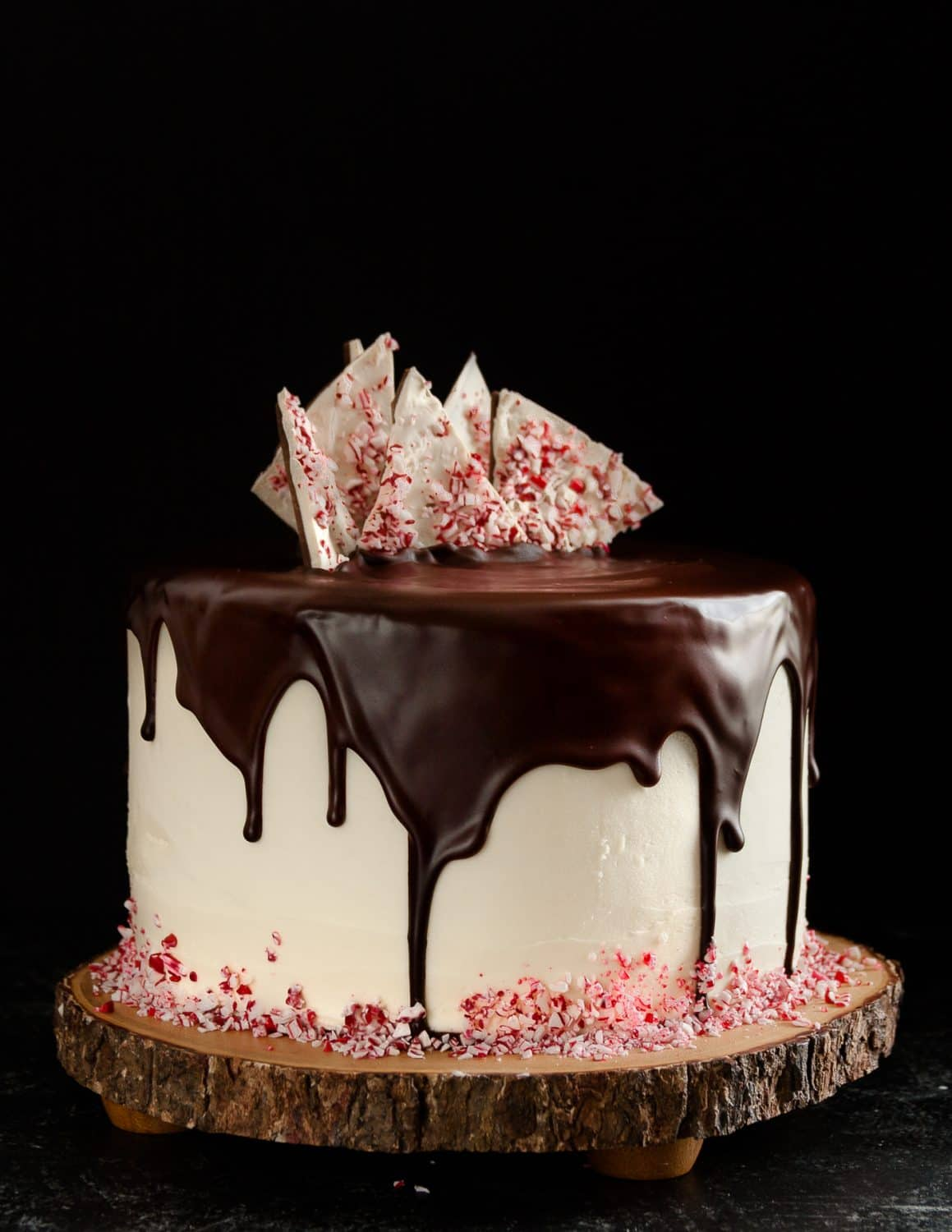 Christmas candy meets Christmas cake in this minty, chocolaty, decadent peppermint bark cake recipe.  * GoodieGodmother.com