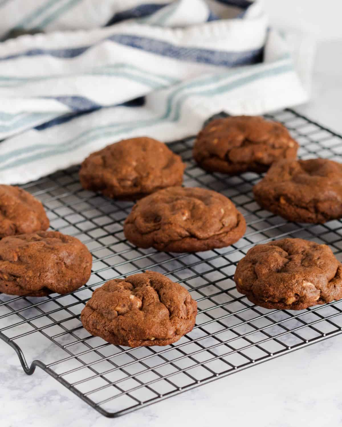 Soft, chewy, thick, and utterly decadent, these bakery style chocolate peanut butter chip cookies taste are milk's best friend.* Recipe on GoodieGodmother.com
