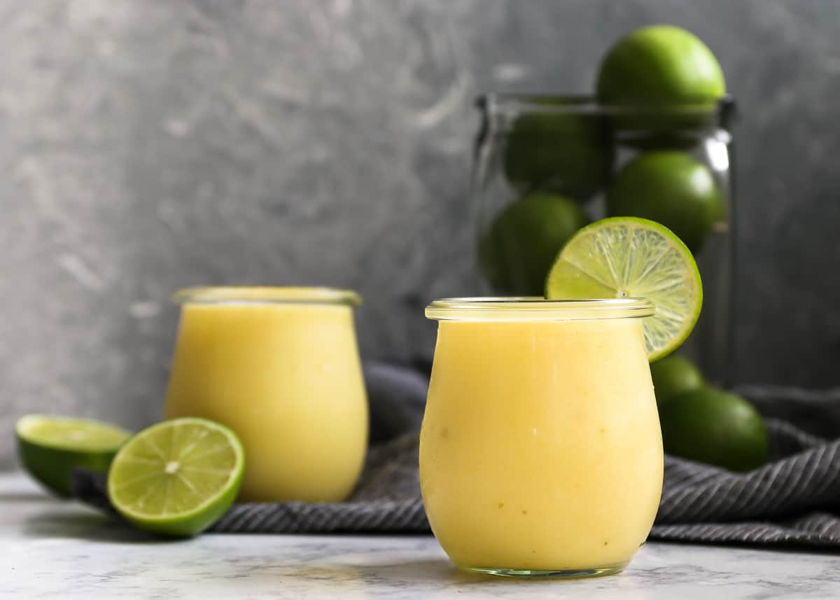Just the right balance of sweet and sour, this lime curd recipe is a must! Use as a spread for scones or pancakes, or an easy filling for cakes and tarts. Ready in minutes, and you can use now or freeze for later.