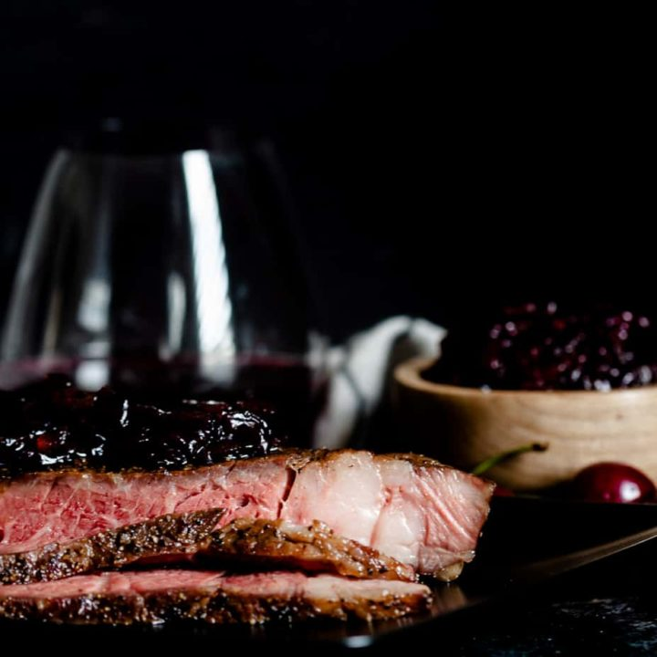 Elevate your steak night with this reverse sear ribeye with cherry onion marmalade. Reverse searing results in juicy ribeye steaks with beautiful color. The cherry onion marmalade is a star supporting condiment - perfect with fresh or frozen cherries! * GoodieGodmother.com
