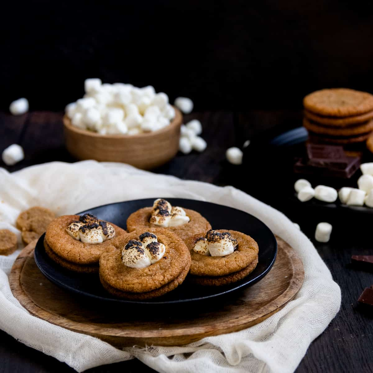 These sandwich s'mores cookies are among the best cookies of all time! Soft graham inspired cookies sandwiching rich chocolate ganache and topped with real roasted marshmallows. Definitely summer's perfect cookie. * GoodieGodmother.com