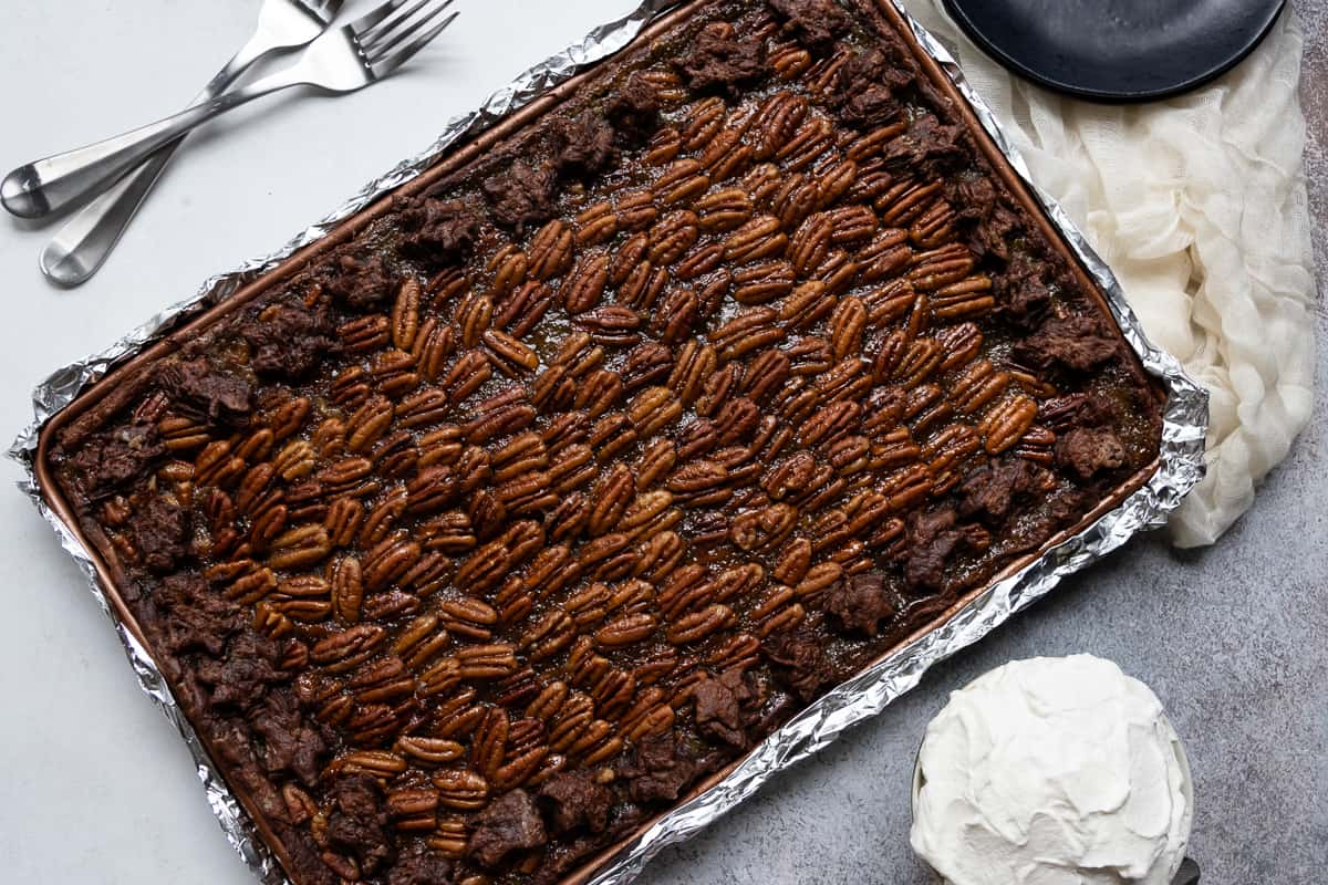 This bourbon chocolate pecan slab pie is the best chocolate pecan pie I've tasted! Nutty, just a bit boozy, and definitely chocolaty, it's always a hit with pecan pie lovers. * Recipe on GoodieGodmother.com
