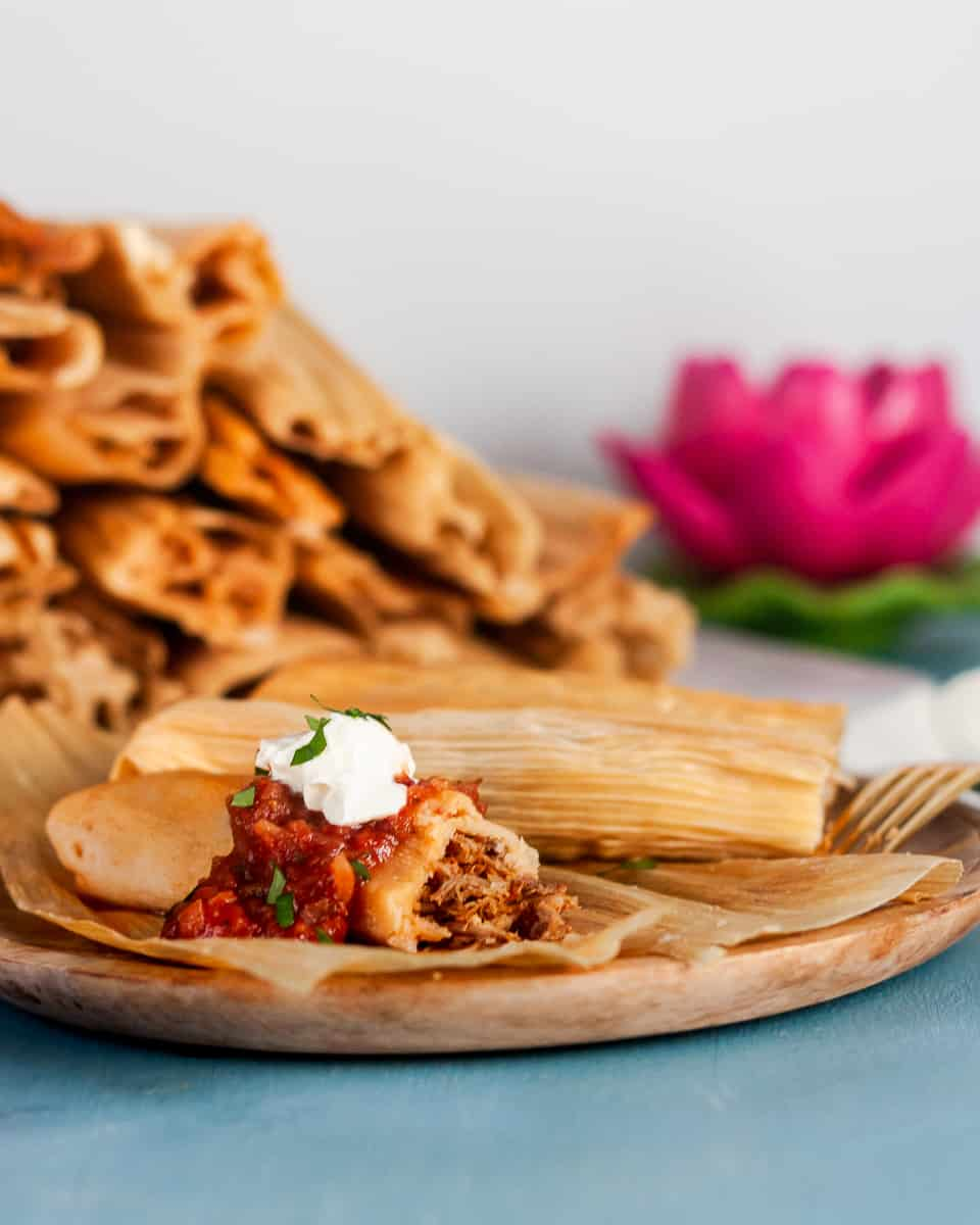 Mexican Pork Tamales are a traditional Christmas food - although they are enjoyed year round! Gather friends, host a tamalada (tamale rolling party), and enjoy! * Recipe on GoodieGodmother.com