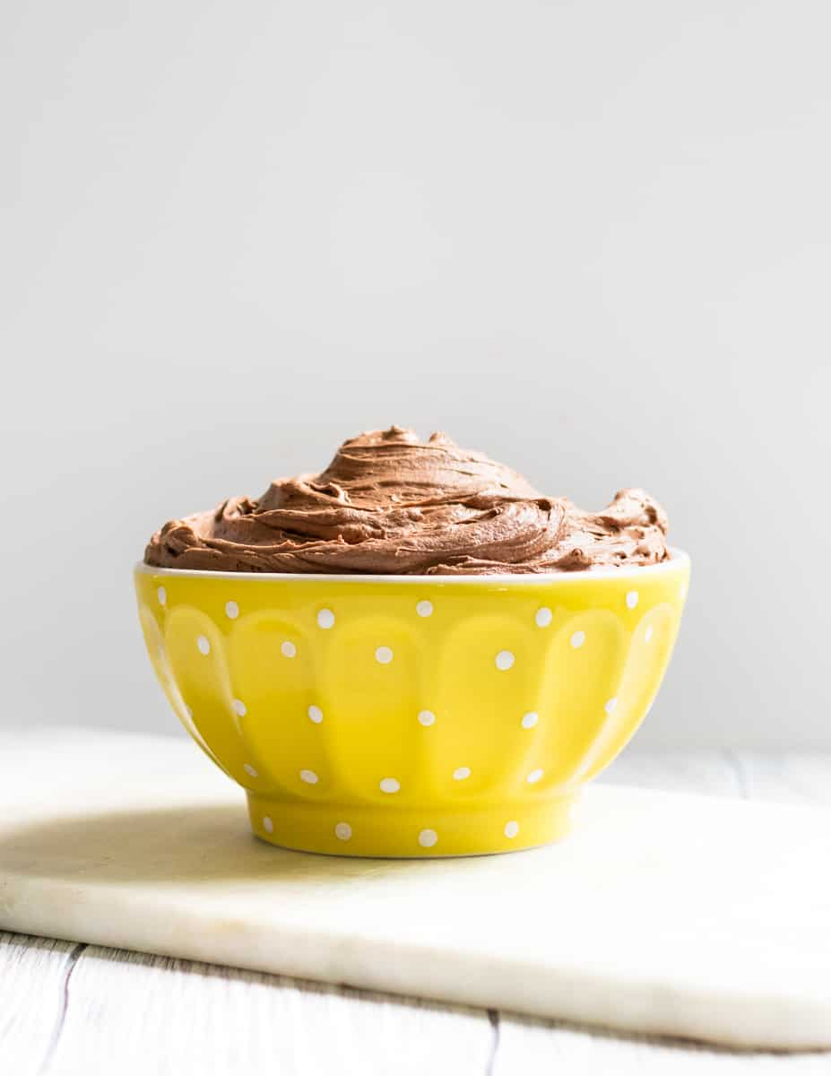 A rich and creamy all butter chocolate American buttercream frosting recipe. This decadent chocolate buttercream frosting gets 2 beaters up! * Recipe on GoodieGodmother.com