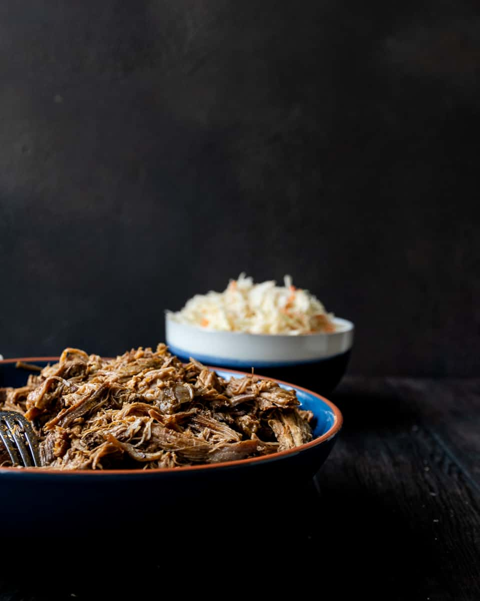 Low and slow is key for this easy slow cooker pulled pork recipe! You'll get smokehouse worthy results with this pulled pork recipe based off Georgia style pork barbecue! * Recipe on GoodieGodmother.com