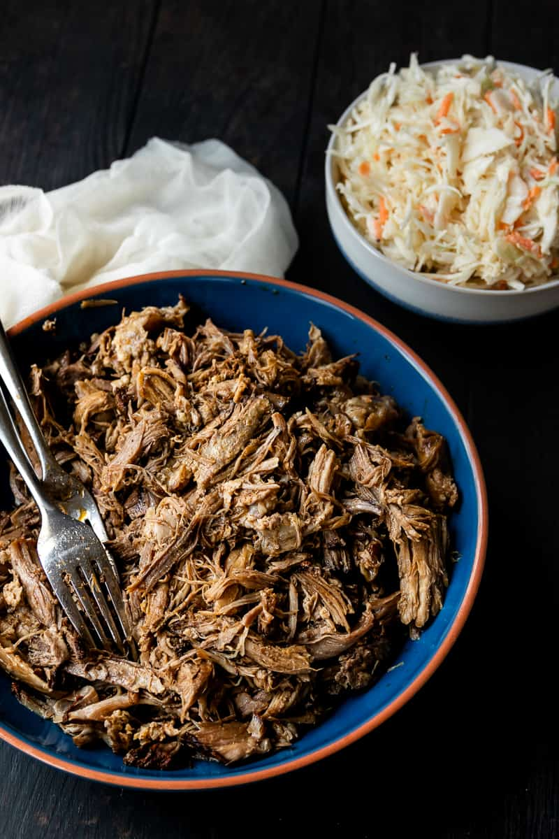 Low and slow is key for this easy slow cooker pulled pork recipe! You'll get smokehouse worthy results with this pulled pork recipe based off Georgia style pork barbecue! Try your hand at this healthy BBQ pork loin cooked in your crock pot. Plus no sauce needed! #porkloin #bbq #crockpotrecipe #pulledpork #easydinner * Recipe on GoodieGodmother.com