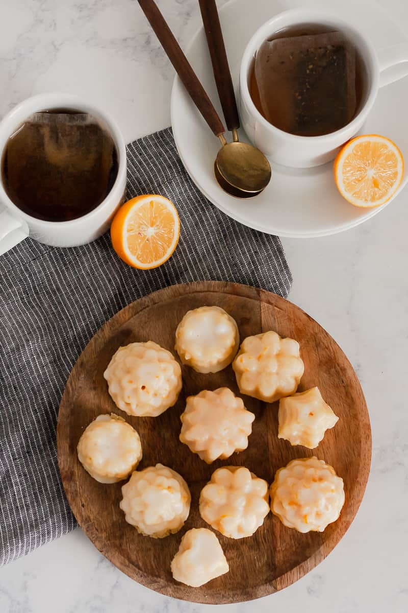 A delicate lemon ricotta pound cake is perfect for baking in mini! Enjoy this Meyer Lemon Pound Cake Bites recipe with a cup of your favorite tea. * GoodieGodmother.com