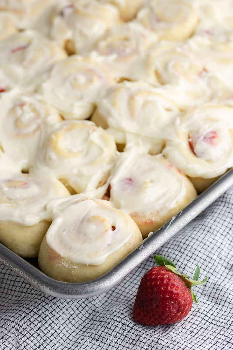 Sweet strawberry jam tucked into pillowy rolls and topped with cream cheese... in mini! You'll want to make these mini strawberry jam sweet rolls ASAP. * Recipe on GoodieGodmother.com
