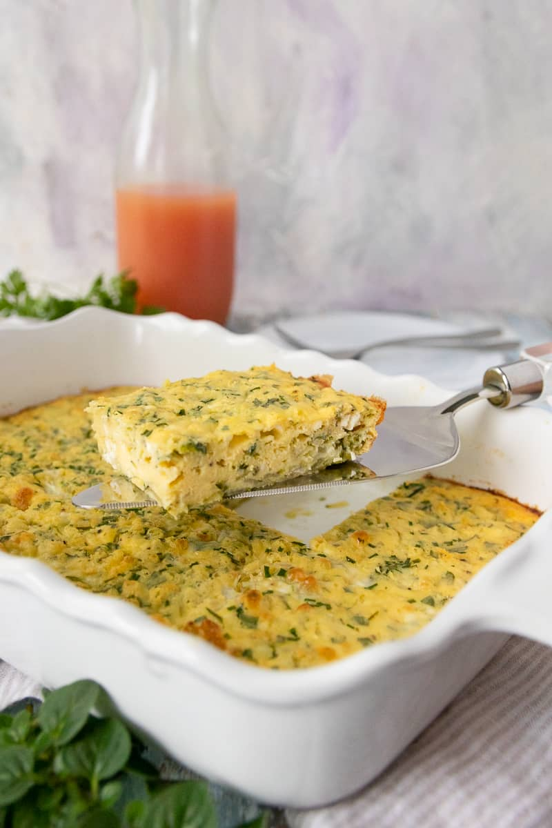 Summer's garden bounty makes a flavorful and easy brunch dish perfect for meal prep or breakfast guests! This fresh herb zucchini egg bake recipe goes from garden to oven in just a few minutes.