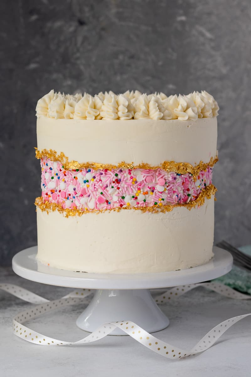 Enjoy everything you love about classic vanilla cake with this moist vanilla cake recipe from scratch! It's the perfect celebration cake recipe, no box mix required. * GoodieGodmother.com