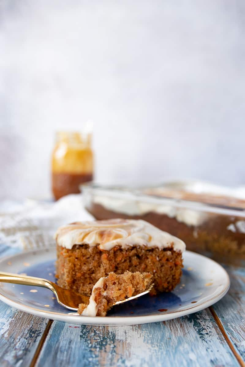 A simple carrot sheet cake with elevated flavor! This carrot spice cake with salted caramel frosting is everything you love about carrot cake without the fuss. * Recipe on GoodieGodmother.com #dessertideas #cakerecipe #carrotcake #sheetcake #easyrecipes #foodideas
