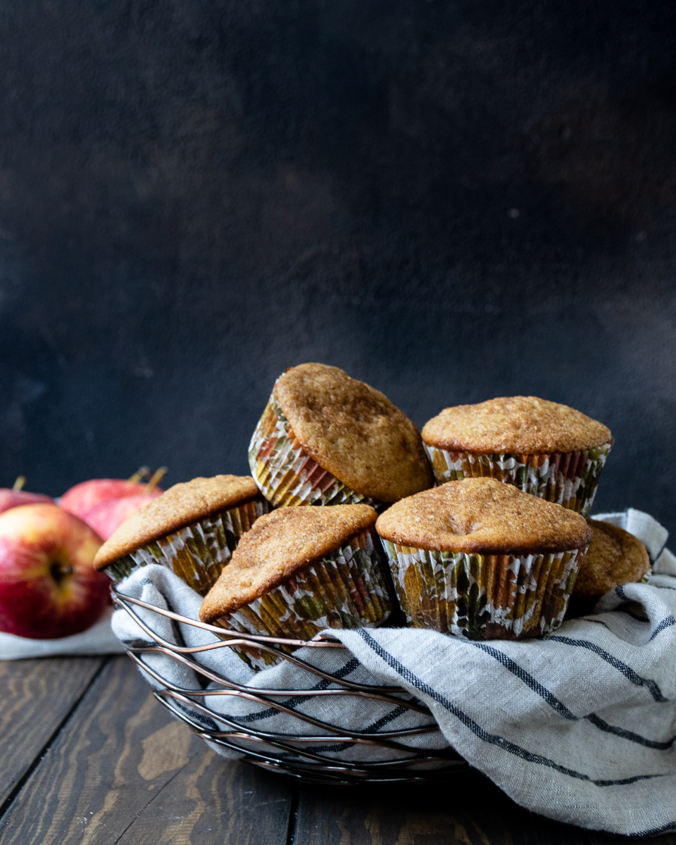 Easy whole wheat apple muffins are a great grab and go fall breakfast option. These muffins are nut free, egg free, and freezer friendly! #howtomake #freezerfriendly #muffins #fallbaking #breakfastideas #mealprep #backtoschool