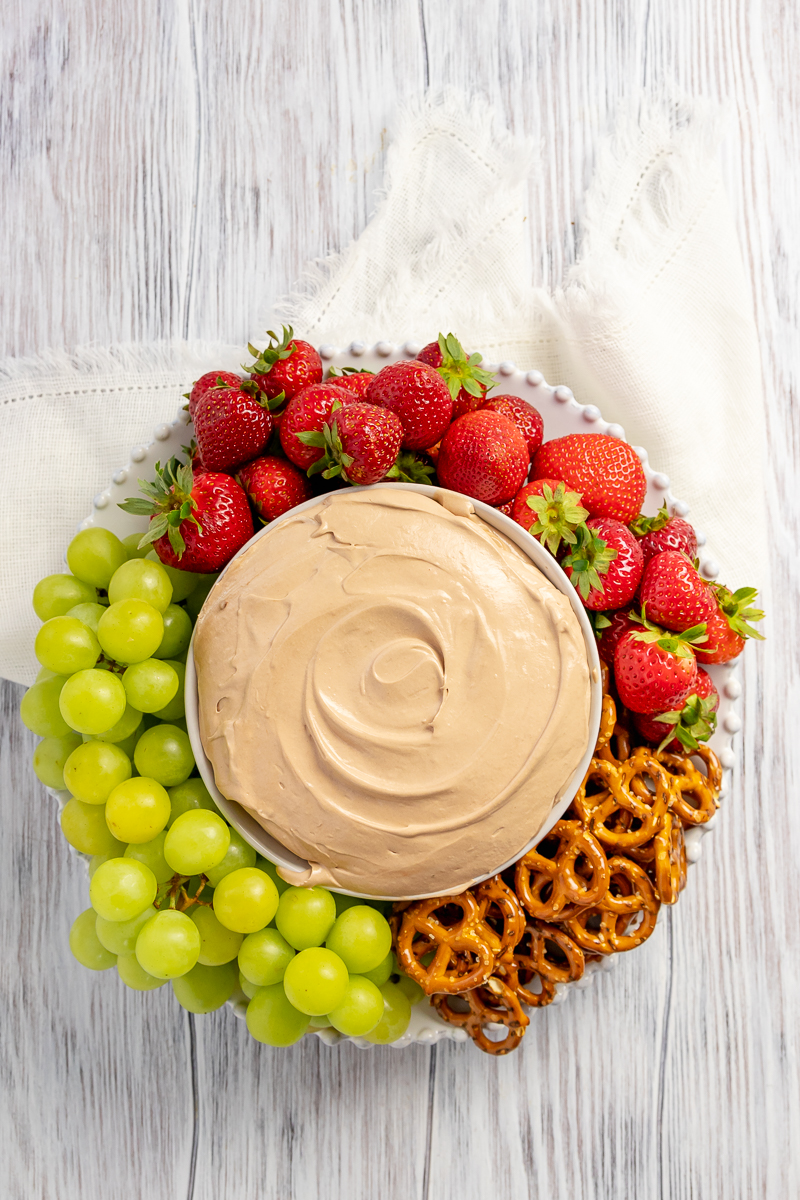 overhead picture of fruit dip to show how pretty a platter would look as part of a party or potluck dessert spread