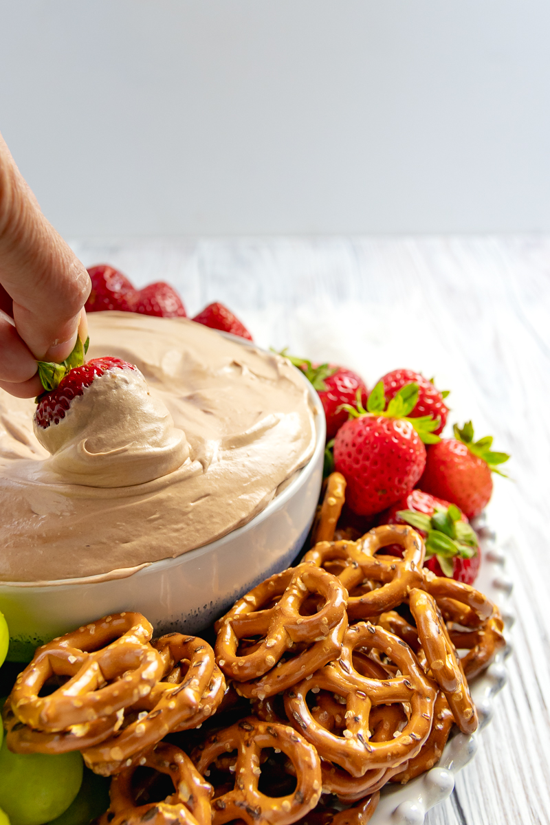 strawberry in fruit dip to show light and creamy texture