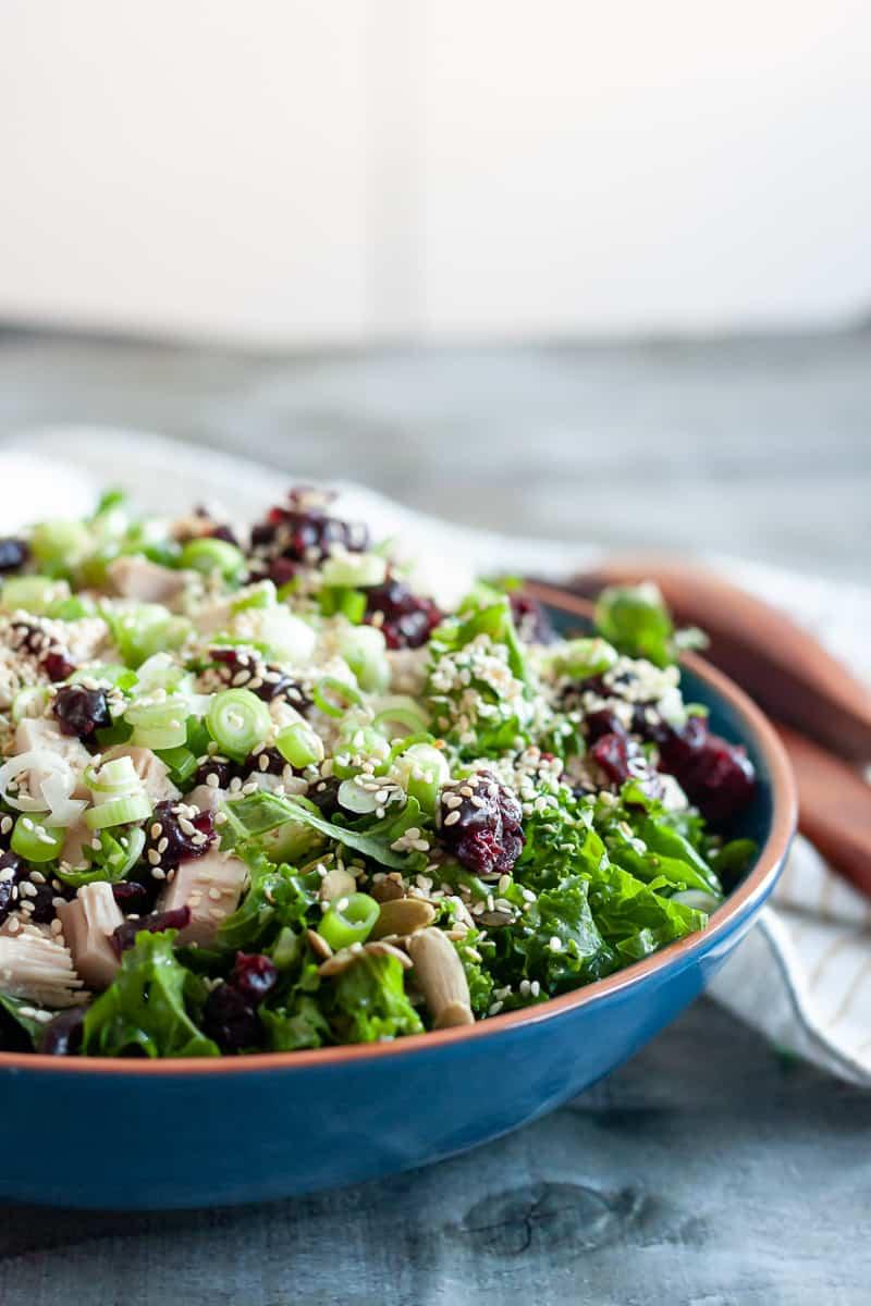 easy turkey kale salad in a blue bowl