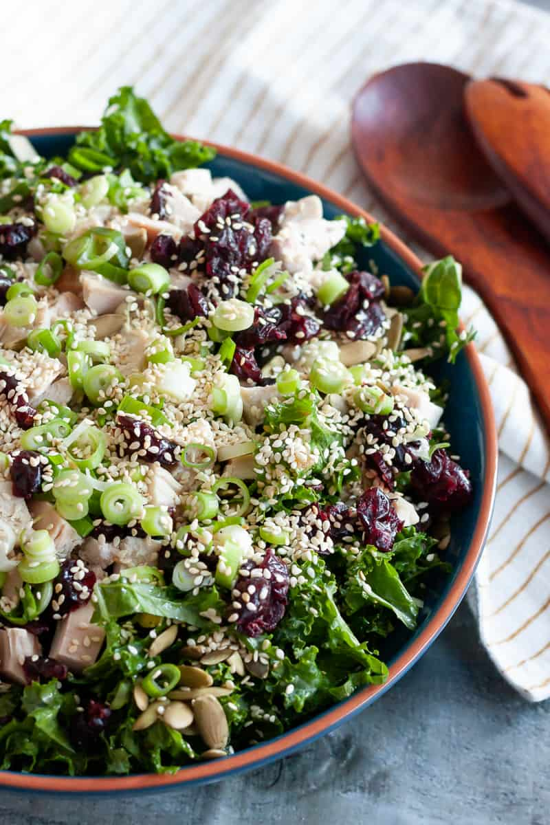 top view of a plated turkey kale salad to highlight textures
