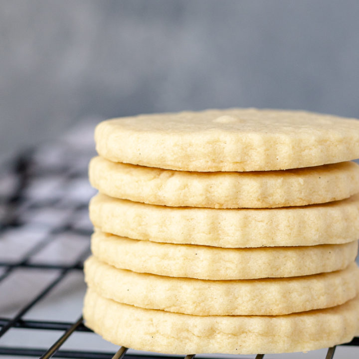 a stack of sugar cookies on a cooling rack