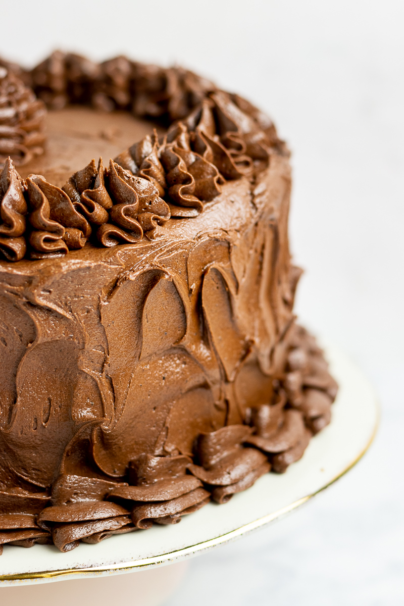 fudge frosting on a cake. picture shows how the frosting looked both piped and spread