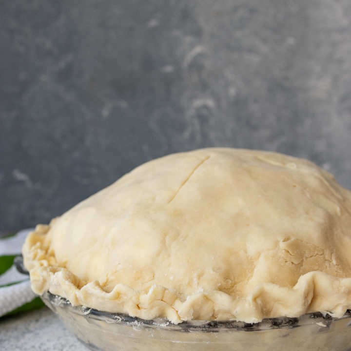 unbaked flaky all butter pie crust on a pie, ready to bake