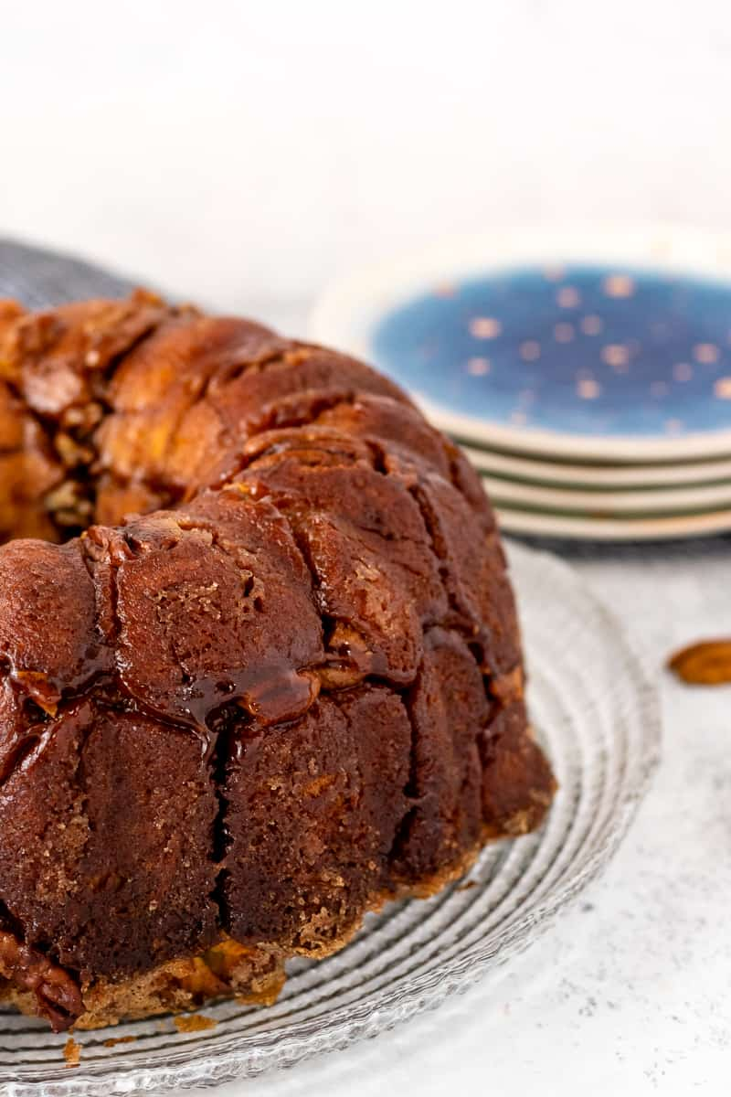 sweet potato monkey bread ready to serve with blue and gold plates in the background