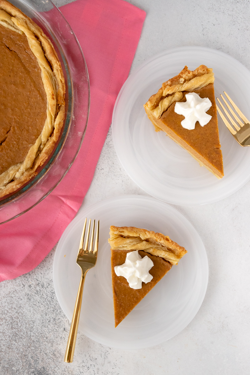 flatlay of sweet potato pie slices with whipped cream