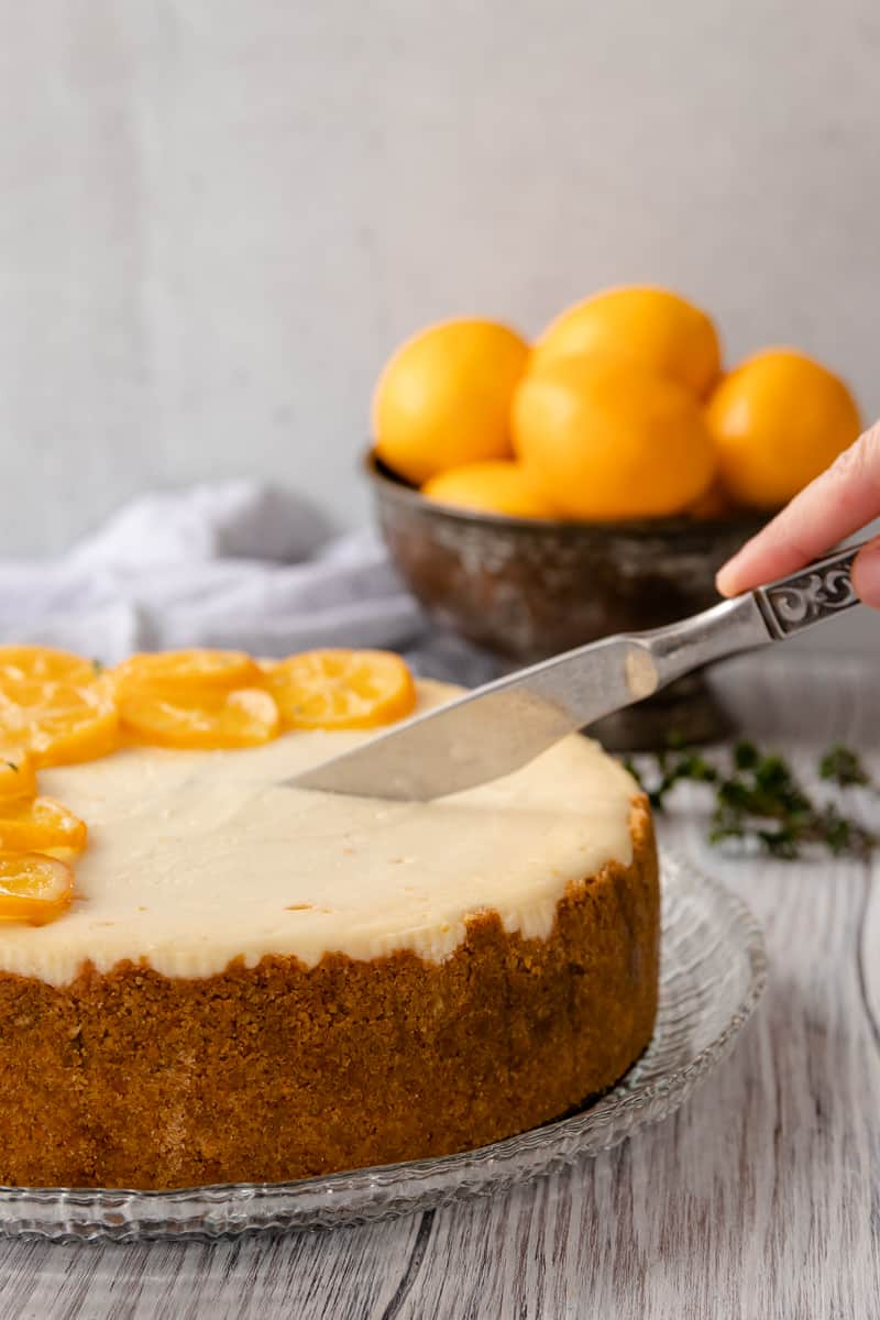 slicing into the meyer lemon cheesecake