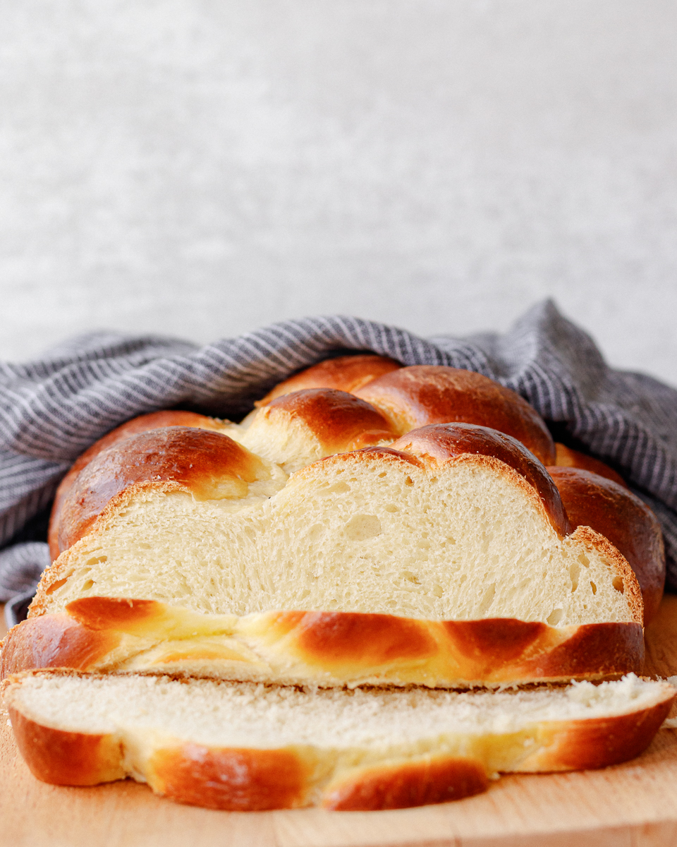 close up of the sliced challah bread to show the beautiful crumb