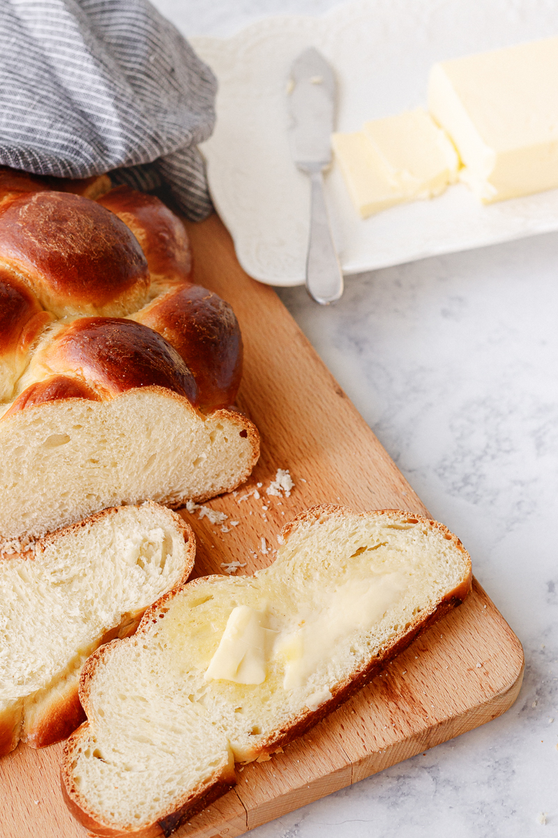 challah bread serving suggestion - shown spread with a bit of butter