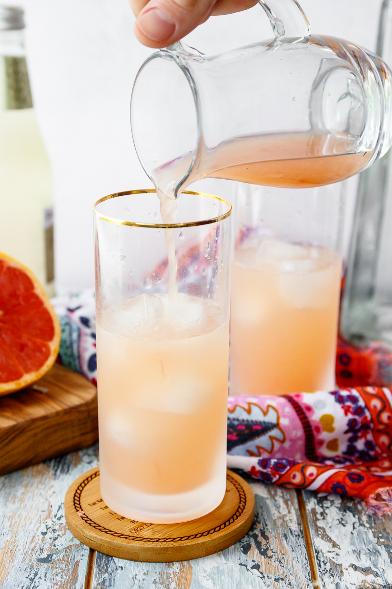 pour fresh grapefruit juice for the best paloma cocktail