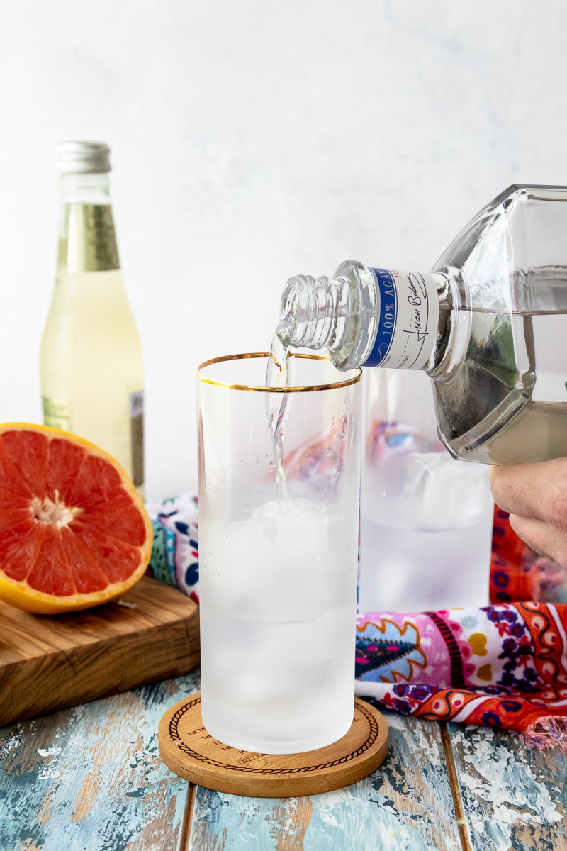 step 1 to making a ginger paloma cocktail - the tequila