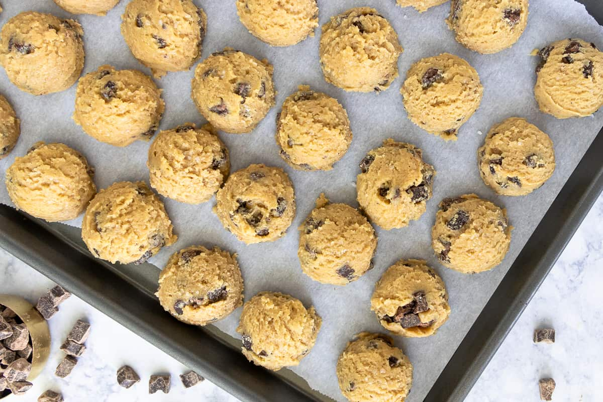 unbaked olive oil cookie dough resting on a baking sheet