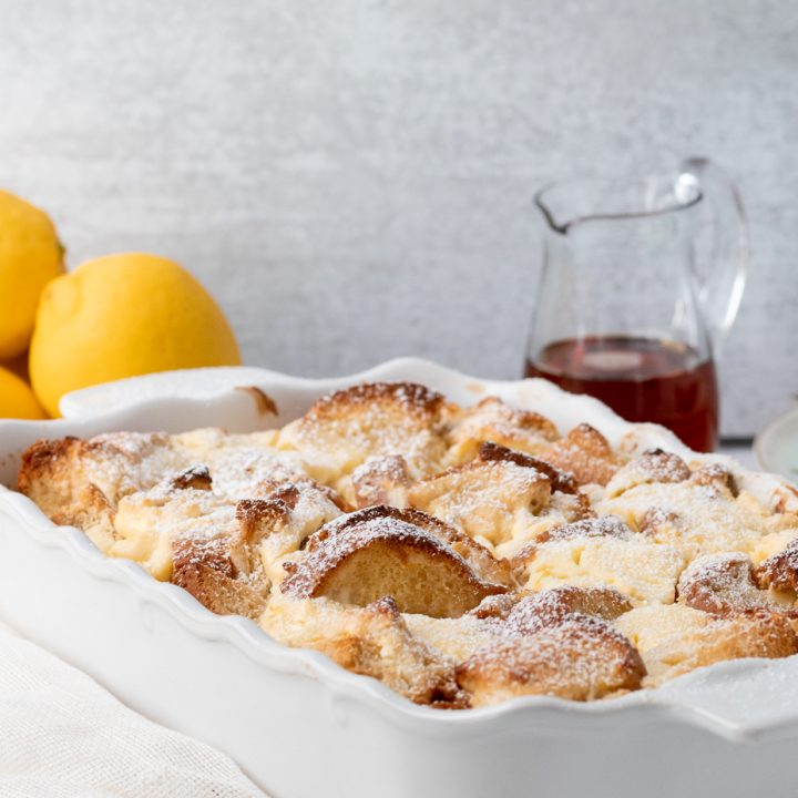 lemon cheesecake french toast casserole dusted with powdered sugar