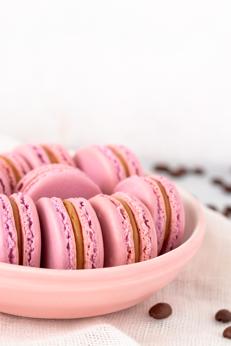raspberry white chocolate mocha latte macarons styled on a plate for serving