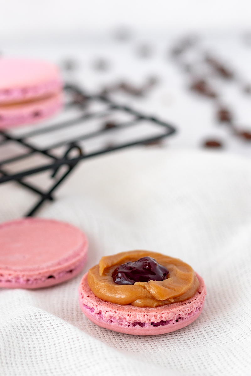 picture of an open macaron showing the filling placement