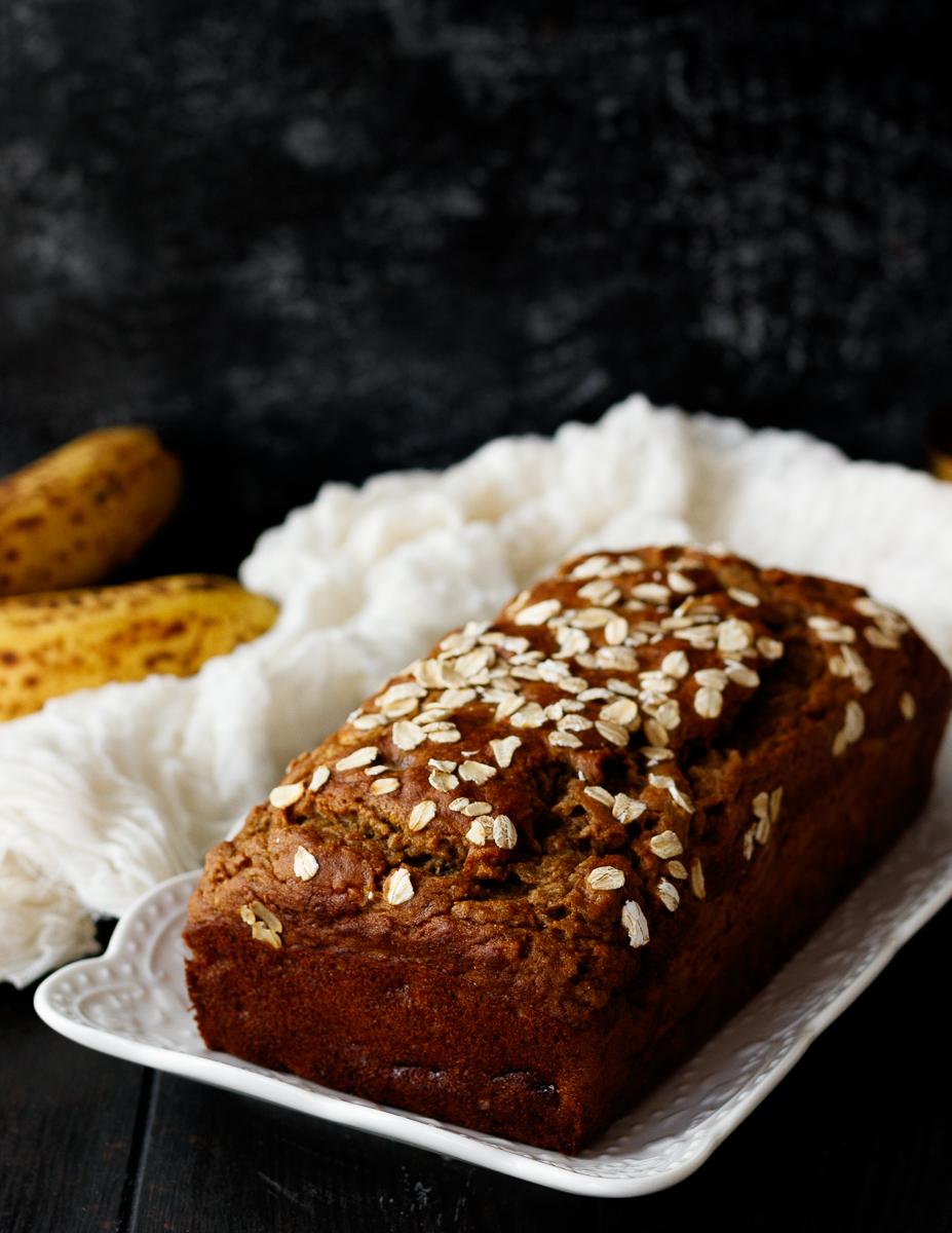 banana bread on a rectangular white plate for serving