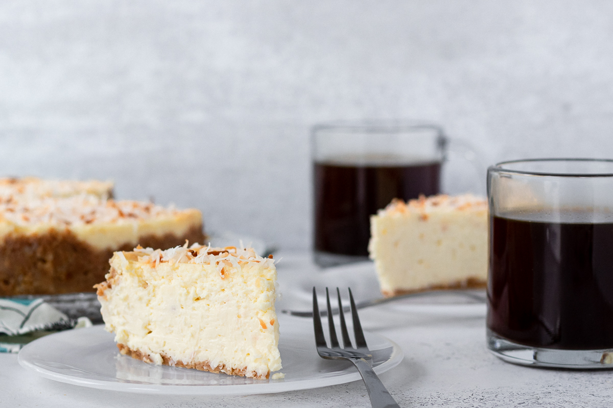 slice of coconut cheesecake on a plate to show the texture