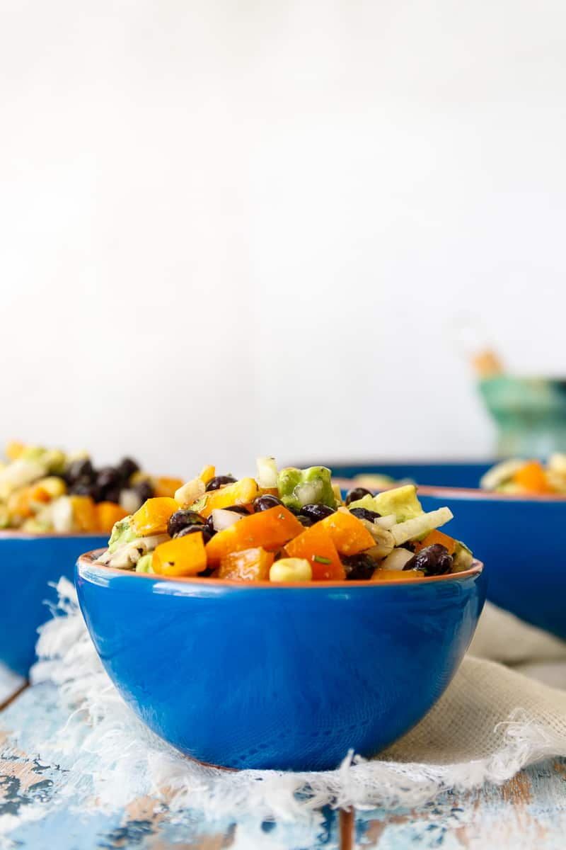 Whip up a delicious and satisfying side dish with mostly pantry and freezer staples! This easy black bean and corn salad recipe is a staple for make-ahead lunches, a quick side for taco night, or an easy picnic or bbq salad.   #beansalad #summersalad #easysaladrecipe #texmex #sidedish #easyrecipe
