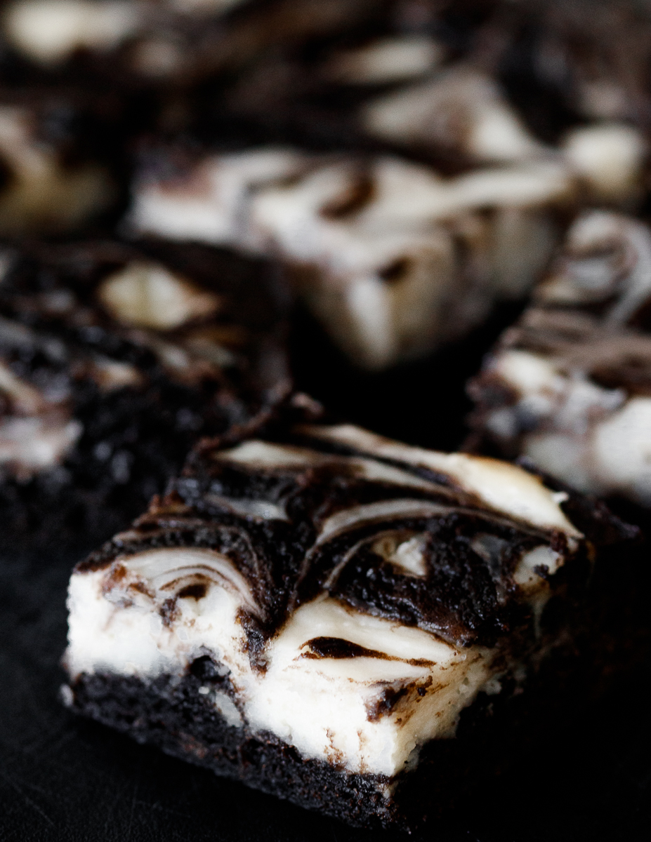 angled top view of the black velvet cheesecake brownies to show the lovely swirl